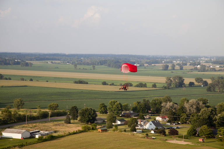 Infinity PPC flying over farm fields